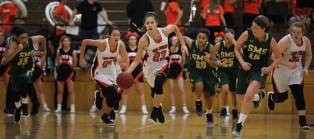 Shawnee Mission Northwest sophomore Hannah Black leads a fast break during the Cougars' 51-40 win over SM South, Friday.