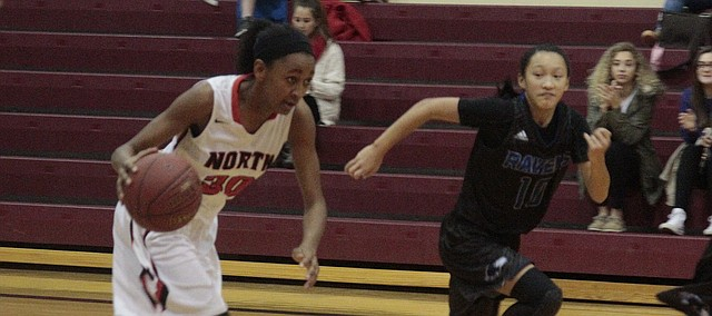 Shawnee Mission North freshman LeLe Love drives past Olathe Northwest's Sami Marks during the Indians' 49-32 loss to the Ravens on Tuesday. Love scored 22 points.