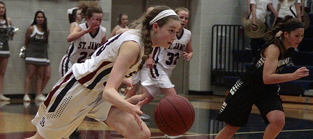 St. James Academy freshman Anna Feldkamp leads a fast break after coming up with a steal in the Thunder's 44-34 loss to Blue Valley Southwest on Thursday.