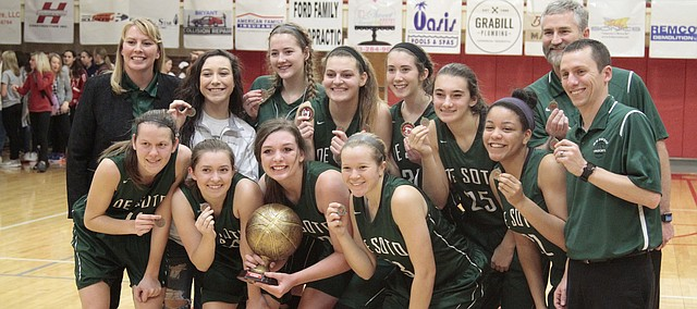 The De Soto girls basketball celebrates its victory over Silver Lake in the Tonganoxie Invitational championship game on Saturday.