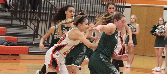 Shawnee Mission Northwest sophomore Hannah Black (23) chases down Free State senior Madison Piper (14) during the second half of the Cougars' 52-50 win over the Firebirds on Friday.