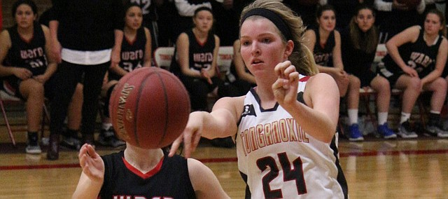 Tonganoxie's Taylor Lee passes the ball in a game earlier this season against Bishop Ward. She scored 23 points against Turner in a victory Friday night.