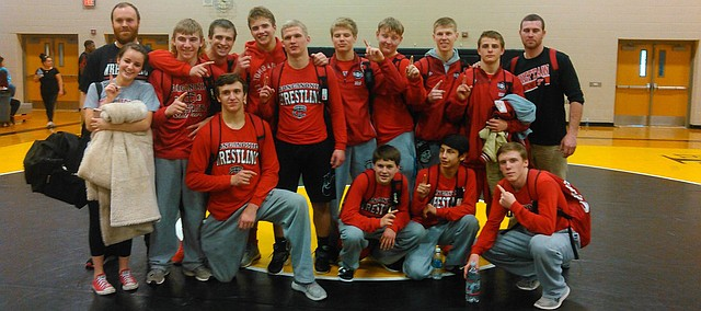 Tonganoxie High wrestlers celebrate a league championship Saturday, Feb. 11, 2017, at Turner High School in Kansas City, Kan. THS was the 2017 co-Kaw Valley League League champions after tying Bonner Springs for the league title.