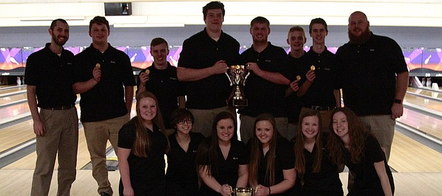 The Shawnee Mission Northwest bowling team gathers for a photo after winning the boys and girls district titles on Thursday at College Lanes. Front row (left to right): Emilia Battles, Charlie Queral, Alaina Burris, Katy Doleshal, Hadley Sayers and Jackie Sayers. Back row (left to right): assistant coach Justin Peterson, Colton Kreie, Garrett Bolin, Kooper Jones, Colton Kinsella, Austin Anderson, Clayton Engelby and head coach Billy Dent.