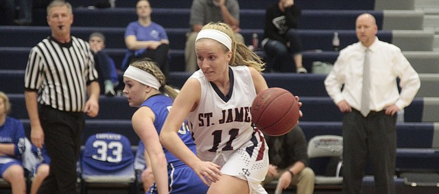 St. James Academy senior Emily Kaufman drives to the basket in the first half of the Thunder's 45-35 loss to Gardner-Edgerton on Thursday. Kaufman led all scorers with 18 points.