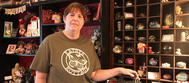 Retired Genesis Christian Academy teacher Kathy Link stands in her new business, Kathy's Kottage, which opened in October. The business is one of many that has opened or is opening in Tonganoxie in recent months.