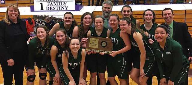 The De Soto girls basketball team stands with their 5A sub-state championship plaque after a 45-34 road win over Pittsburg on Friday. Front row (left to right): Assistant coach DeAnn Thaemert, Hannah Wilson, Jackie Kennard and Mara Montgomery. Middle row (left to right): Mariah Grizzle, Julia Johnson, Madison Plake, Tanith Beal, Sydney Jones and Linnea Searls. Back row (left to right): Assistant coach Bruce Yarbrough, Ellie Bream, Mackenzie Shupe and head coach Ryan Robie.