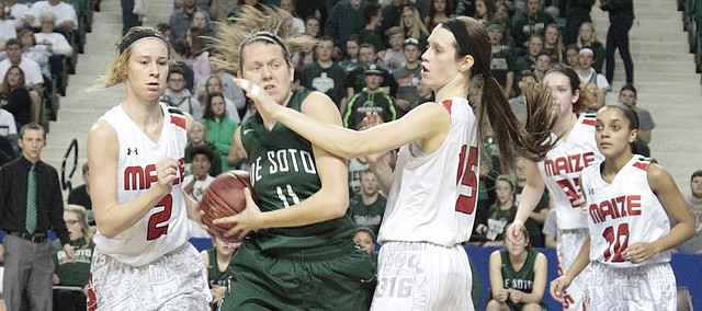 De Soto senior Sydney Jones tries to penetrate though the Maize defense in the second half of the Wildcats' 51-17 loss in the first round of the Class 5A state tournament on Wednesday at the Kansas Expocentre in Topeka.