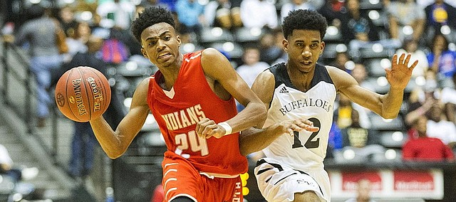 Shawnee Mission North's Michael Weathers (24) pushes past Wichita Southeast's Brycen Cobbins (12) as he pushes the ball up the court during the 2016 state championship game on Saturday in Wichita. Weathers, now a freshman at Miami (Ohio), was named the MAC Freshman of the Year on Tuesday.