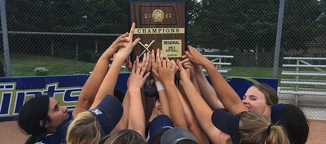 The Mill Valley softball team holds up its Class 5A regional championship plaque after its wins over St. James Academy and St. Thomas Aquinas on Tuesday.
