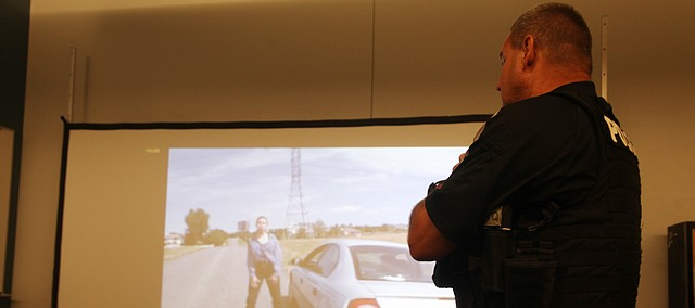 A Tonganoxie police officer goes through a scenario Friday at the Tonganoxie Police Station conference room. Officers did training through a program the city's insurance company provided for a week of training.