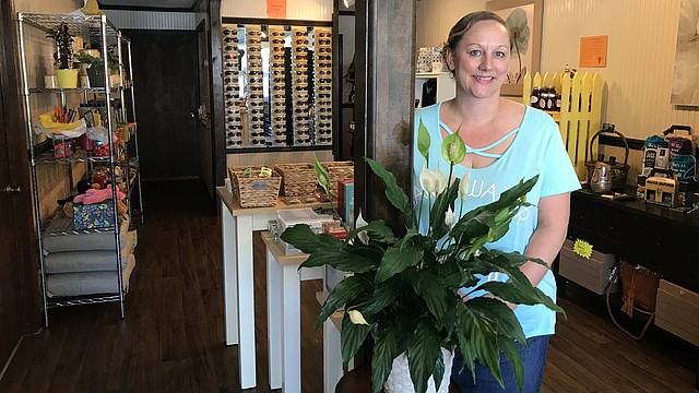Alissa Griffin stands inside her store, Fun and Fabulous Floral and Gifts. The business opened earlier this year in the former optometry office of Dick Dean and Katie Volk.