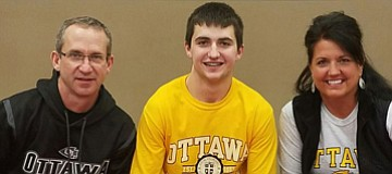 Keaton Rickard signs earlier this year with Ottawa University to play football at the NAIA school. Also in attendance were his parents, Chris and Niki Rickard.