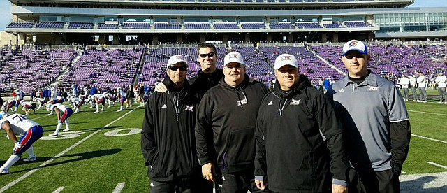 "Brandon Mellen, Tonganoxie High's new activities director and assistant principal, also has served as a basketball official, assistant basketball coach and ""ball boy"" for Kansas football. Mellen, second from left, stands with other sideline crew members during this past November's KU game in Manhattan against Kansas State."