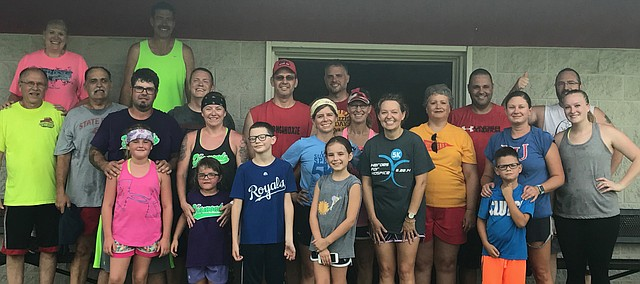 Tonganoxie Achieving Success Together participants gather after workouts Sunday, Aug. 13, 2017, at Chieftain Park. FAST is in its second week of the latest session, which ends Oct. 1.