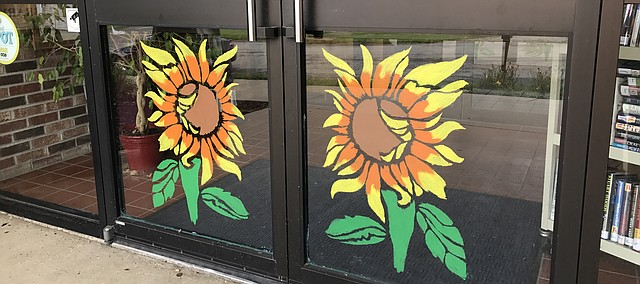 Sunflowers are popping up in downtown Tonganoxie storefronts. They also can be found, as pictured here, at Tonganoxie Public Library.