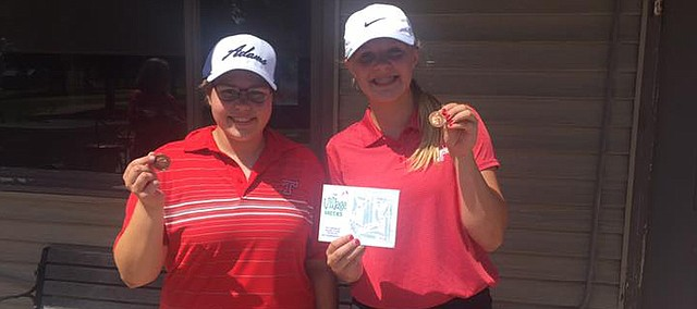 Tonganoxie High's girls golf team has its first hardware in school history. Savannah Adams and Morgan Brusven placed this week in the first competition for the new program.