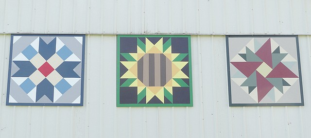 Barn quilt blocks now adorn the east side of the Tonganoxie Community Historical Society barn.