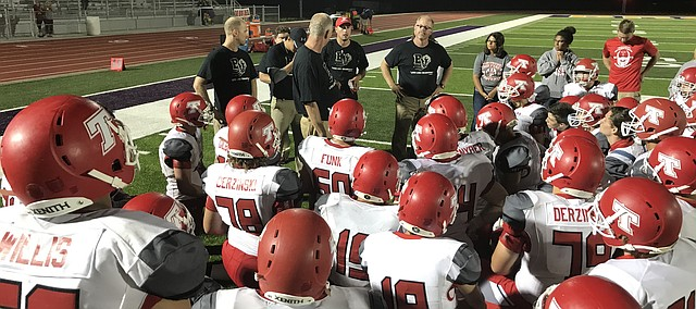 Tonganoxie High coaches talk to their players Friday, Sept. 1, 2017, after THS defeated Spring Hill, 23-14, at the SHHS football stadium. The facility just opened, as the game between the two schools was the first to be played at the new Bronco stadium.