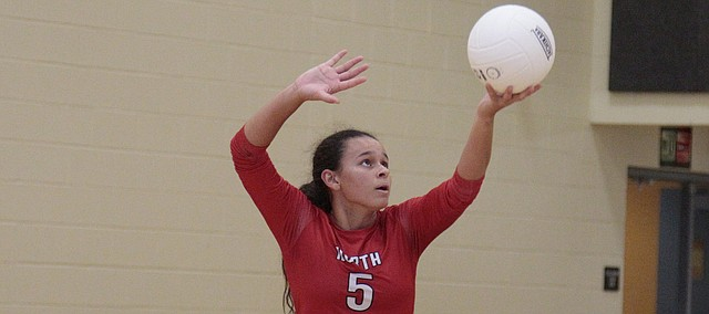 Shawnee Mission North's Chanelle Boldridge serves up a point in the Indians' 25-9, 25-15, 25-7 loss to SM West on Tuesday.