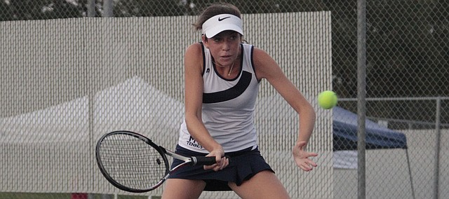 Mill Valley freshman Sophie Lecuru hits a volley in the No. 1 singles championship match of the Jaguar Invitational on Saturday against De Soto's Issa Sullivan. Lecuru lost to Sullivan in a tiebreaker, but helped the Jaguars to a first-place team finish.