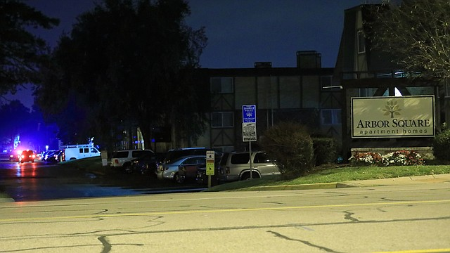 Shawnee Police and the Johnson County Sheriff's Office Crime Lab at the scene of a shooting in the Arbor Square apartments early Thursday morning.
