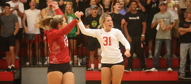 Tonganoxie High's Mackenzie Sample celebrates with teammates during a match earlier this season against Eudora in Tonganoxie.