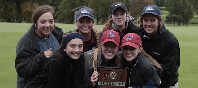 The St. James Academy girls golf team poses for a photo with its Class 5A regional runner-up plaque on Tuesday at the Sykes/Lady Overland Park Golf Club. Front row, from left: Jane Grant, Mary Kate Krebs and Sammy Hemke. Back row, from left: Alex Cozzitorto, Allison Comer, Kelly Krebs and Kate Duggan.