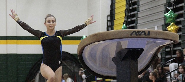 Shawnee Mission Northwest senior Hallie Ross approaches the vault on Tuesday during the SM South All-Around Invitational.  Ross placed second on the vault, uneven bars and beam and finished fourth in the floor exercise to claim the all-around title.