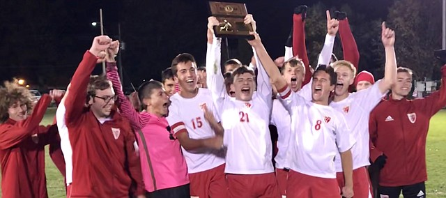 Tonganoxie High soccer players celebrate a Class 4-1A regional title Thursday after the Chieftains outlasted the Maranatha Eagles, 3-2, in overtime Oct. 26, 2017.