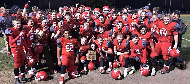 Tonganoxie High football celebrates a victory against Basehor-Linwood, 10-3, Oct. 27, 2017. The victory gave THS its first undefeated regular season since 1962, an outright Kaw Valley League title in he final season of the conference and a district title.