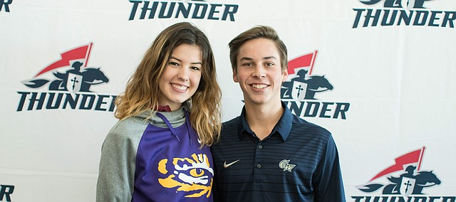 St. James Academy seniors Allison Coens (left) and Blake Ripp (right) pose for a photo at the Thunder's fall signing day ceremony on Wednesday. Coens signed to play beach volleyball at LSU, while Ripp made it official by inking with George Washington to continue his baseball career.