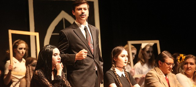 Harrison York (Gomez Addams) speaks as Morticia (Allison Williams), Wednesday (Hannah Kobe), Lucas Beineke (Jack Duvall) and Alice Beineke (Gabby Crockett) look on.