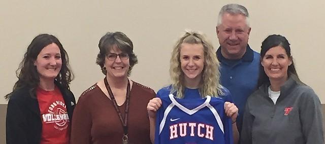 Lauren Willson holds up a Hutchinson Community College volleyball jersey during a National Letter of Intent signing ceremony Thursday at the Chieftain Room on the Tonganoxie High School campus. The THS senior plans to continue her career at HCC next fall. Joining her for the photo are, from left, THS coach Chrissie Jeannin, Lauren's parents, Jean and Bill Willson, and former THS coach Tiffany Parker.