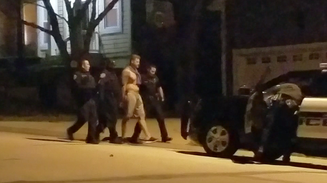 Shawnee Police walked a shirtless and handcuffed O'Connell from the house to a waiting patrol vehicle and he was quickly taken away from the scene.