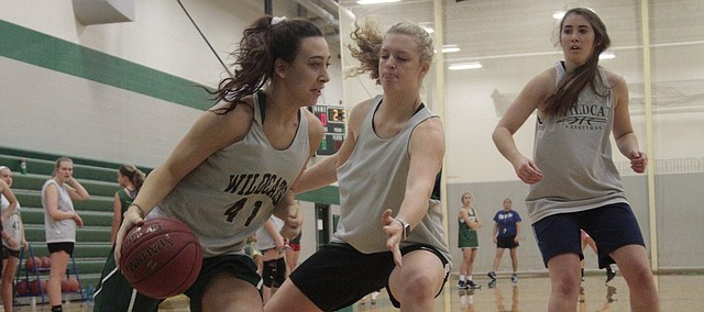 De Soto senior Mara Montgomery drives baseline during practice on Nov. 14.