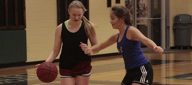 Maranatha Christian Academy junior Alyssa Buetter (left) tries to dribble past senior Allison Dighton (right) during a drill in practice on Nov. 17