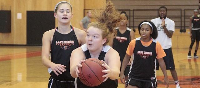 Shawnee Mission Northwest senior Sarah Petersen goes up strong during practice on Nov. 20.