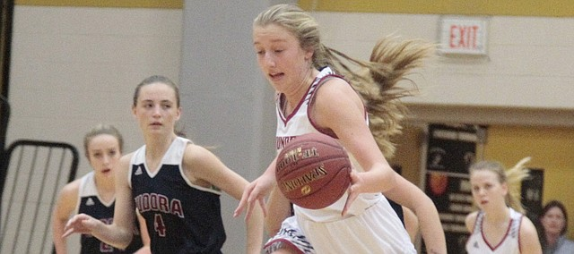 St. James freshman Abby Dunsmore comes up with a steal in the first half of the Thunder's 45-28 win over Eudora on Tuesday in the consolation semifinals of the Paola tournament.