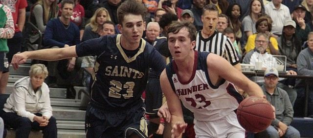 St. James sophomore Jack Moellers drives to the basket in the first half of the Thunder's 45-42 loss to St. Thomas Aquinas on Wednesday.