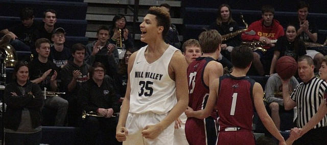 Mill Valley freshman Keeshawn Mason flexes his muscles after making the bucket and getting fouled in the fourth quarter of the Jaguars' 43-41 win over St. James on Wednesday.