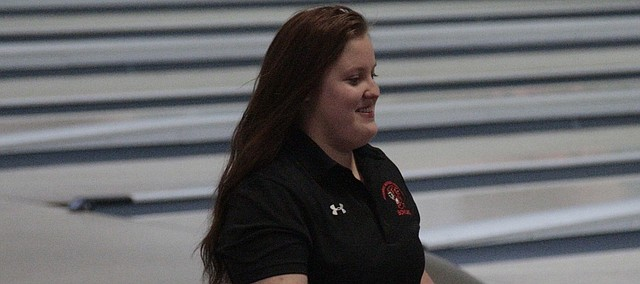 Shawnee Mission Northwest senior Alaina Burris walks up to receive her second-place medal on Friday at the Free State Invitational girls bowling tournament at Royal Crest Lanes.