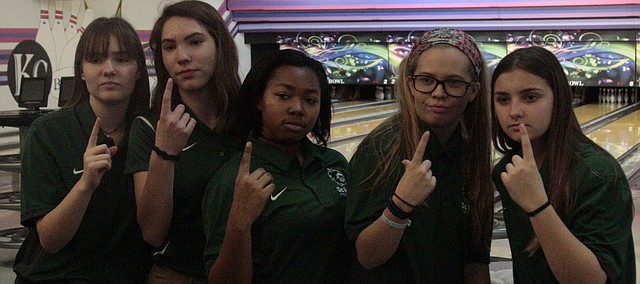 From left: De Soto's Savannah Miles, Ella Fixsen, Tiye' Kindred, Amaya Pingry and Maddy Calvello hold up the No. 1 after winning Monday's triangular at KC Bowl.