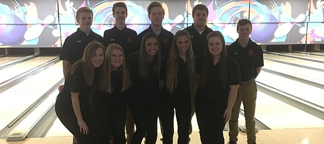 Shawnee Mission Northwest's senior bowlers gather for a photo before the Cougars' senior night quad on Monday. Front row (from left): Hadley Sayers, Emilia Battles, Brooke Haley, Camille Haley and Alaina Burris. Back row (from left): Austin Andersen, Clayton Engelby, Aaron Masters, Travis Morrison and Garrett Bolin.