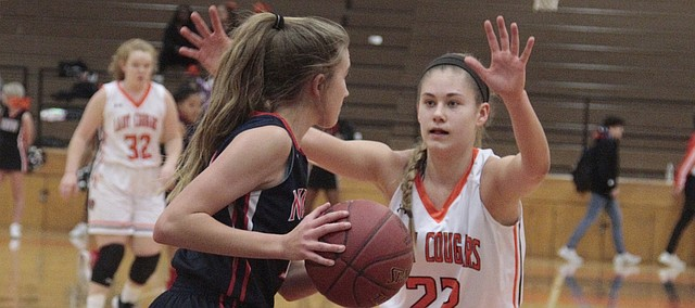 Shawnee Mission Northwest junior Hannah Black keeps her hands up on defense in the first half of the Cougars' 57-28 win over Olathe North on Tuesday.