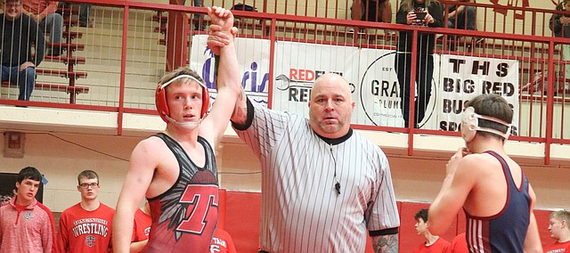 Tonganoxie High's Aiden McClellan wins a match earlier this year during a home competition at the THS gymnasium. THS will compete Friday and Saturday at a Class 4A regional in Holton.