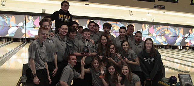 The Mill Valley bowling team takes a photo with the Cat Cup on Thursday at Park Lanes. The Jaguars finished second in the boys and girls team standings in the Battle for Park Lanes, but edged De Soto for the Cat Cup.