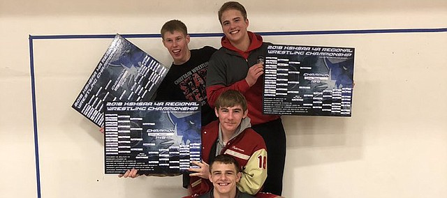 Tonganoxie High wrestlers, from top left to bottom, Gad Huseman, Connor Searcy, Patterson Starcher and Korbin Riedel, display their championship brackets after winning their respective weight divisions.THS will be sending seven wrestlers total Friday to Salina for the two-day Class 4A state tournament.