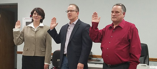 Tonganoxie City Council members, from left, Loralee Stevens, Jamie Lawson and Rocky Himpel are sworn in Jan. 8, 2018.