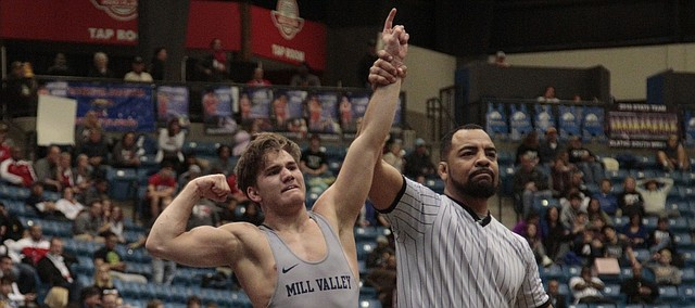 Mill Valley senior wrestler Conner Ward gets his arm raised by the referee after winning a Class 5A state title on Saturday at Hartman Arena in Park City.